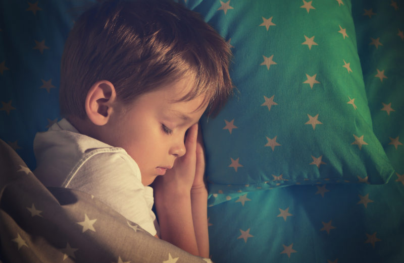 kids and sleep; Adorable little boy sleeping in bed