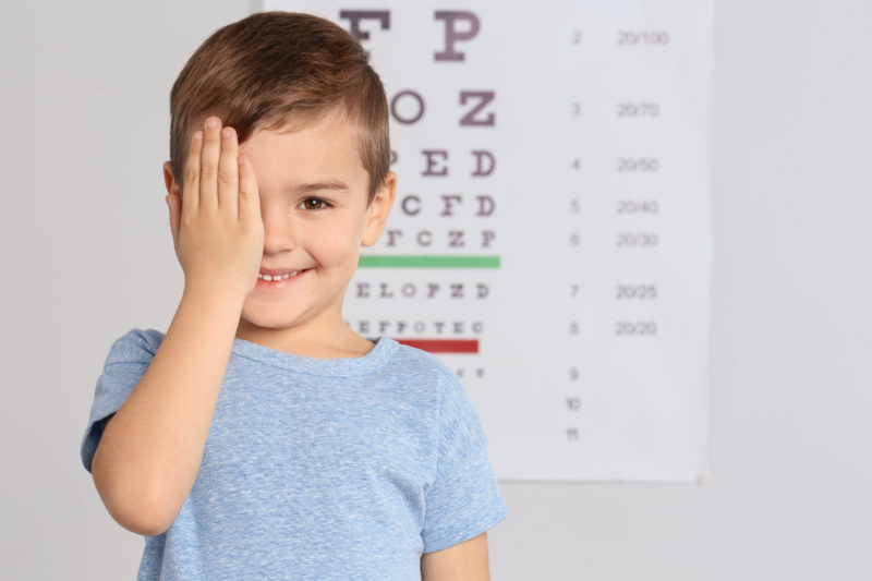 Cute little boy visiting children's doctor, space for text. Eye Exams for Children