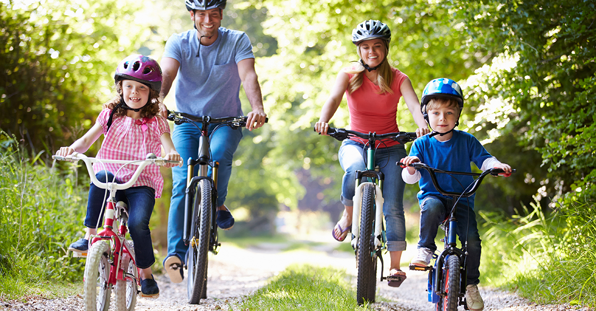 Family On Cycle Ride In Countryside; blog: 8 Ways to Encourage Your Child to Be Physically Active