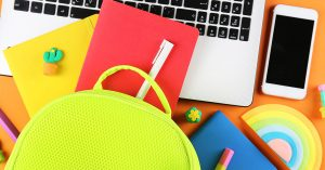 Hipster neon green textile backpack, surrounded with school supplies. Back to school concept. Lots of different stationery items on colorful background. Close up, copy space, flat lay, top view; Blog: Back to School Prep: 8 Things for Your Checklist