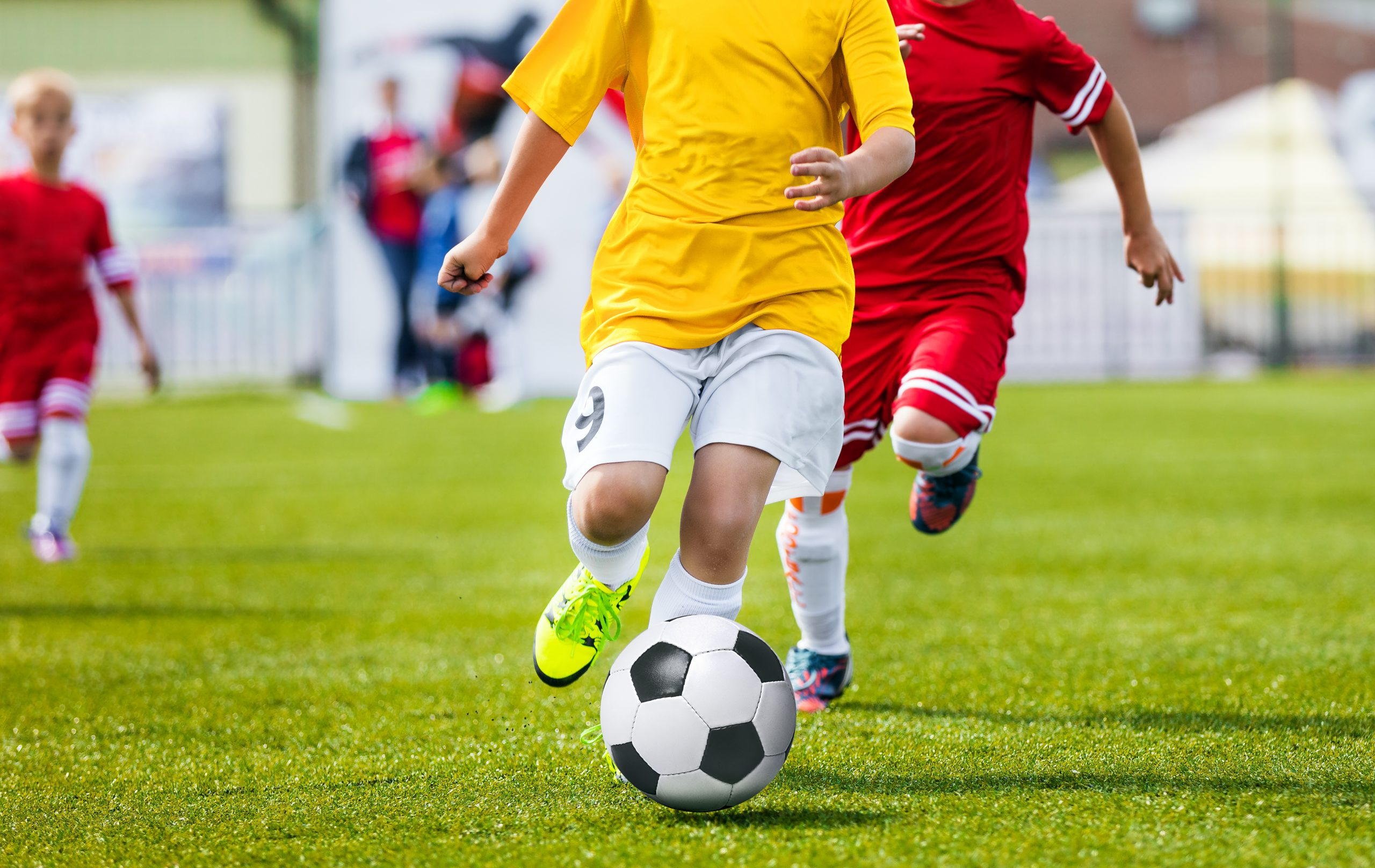 Running Youth Soccer Football Players. Boys Kicking Soccer Match. Children Football Players Running After the Ball. Kids Sport Duel